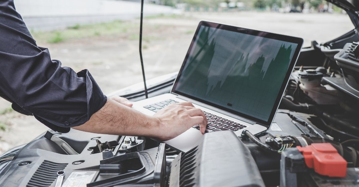 Man searching for car parts on laptop