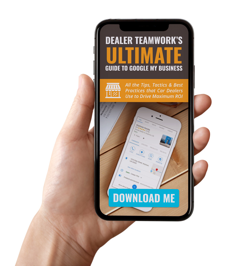 Person looking at Dealer Teamwork's Ultimate Guide to GMB Ebook on a phone