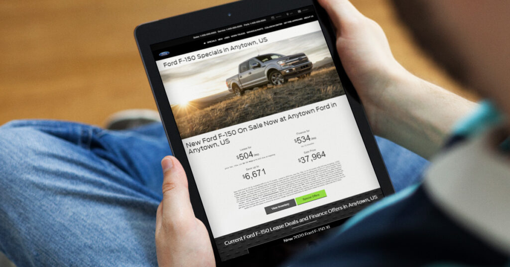 person looking at a ford landing page on a tablet