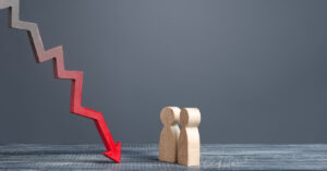 down arrow and wooden people figurines